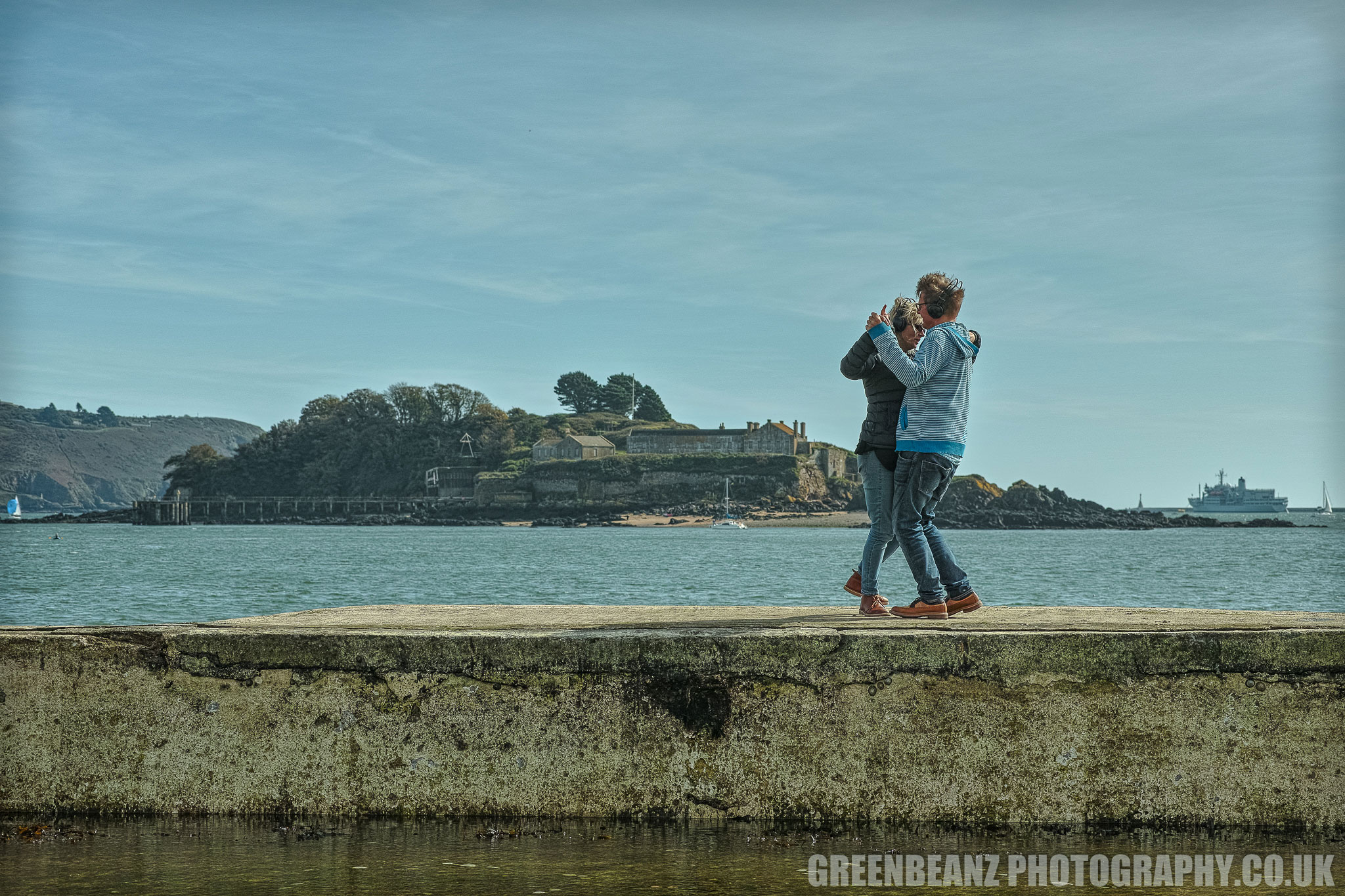 A couple dance to Ronald Binge's 'Sailing By' on the sea wall at Plymouth's Devil's Point Tidal Pool