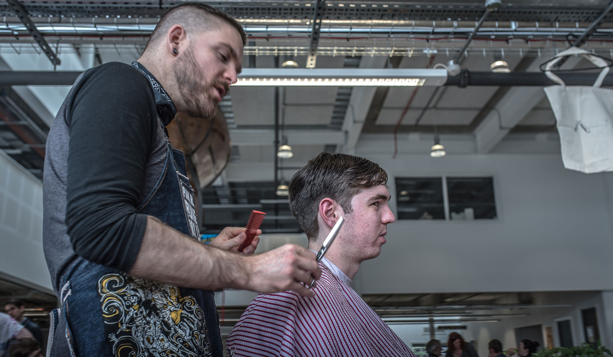Pop up Barber Cut the Punx with scissorsr and customer