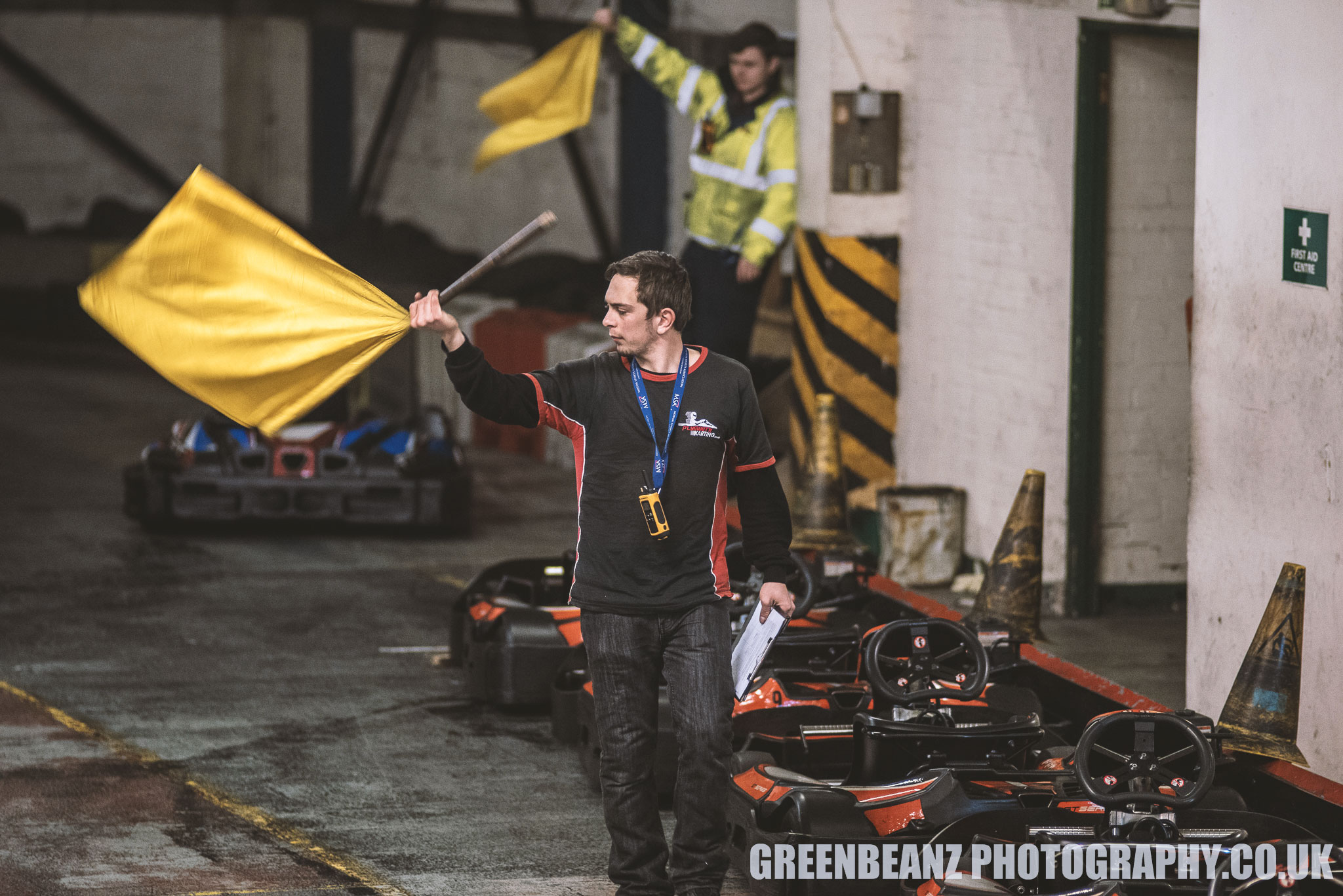 Yellow flag being waved at Plymouth Karting Motorsport Event