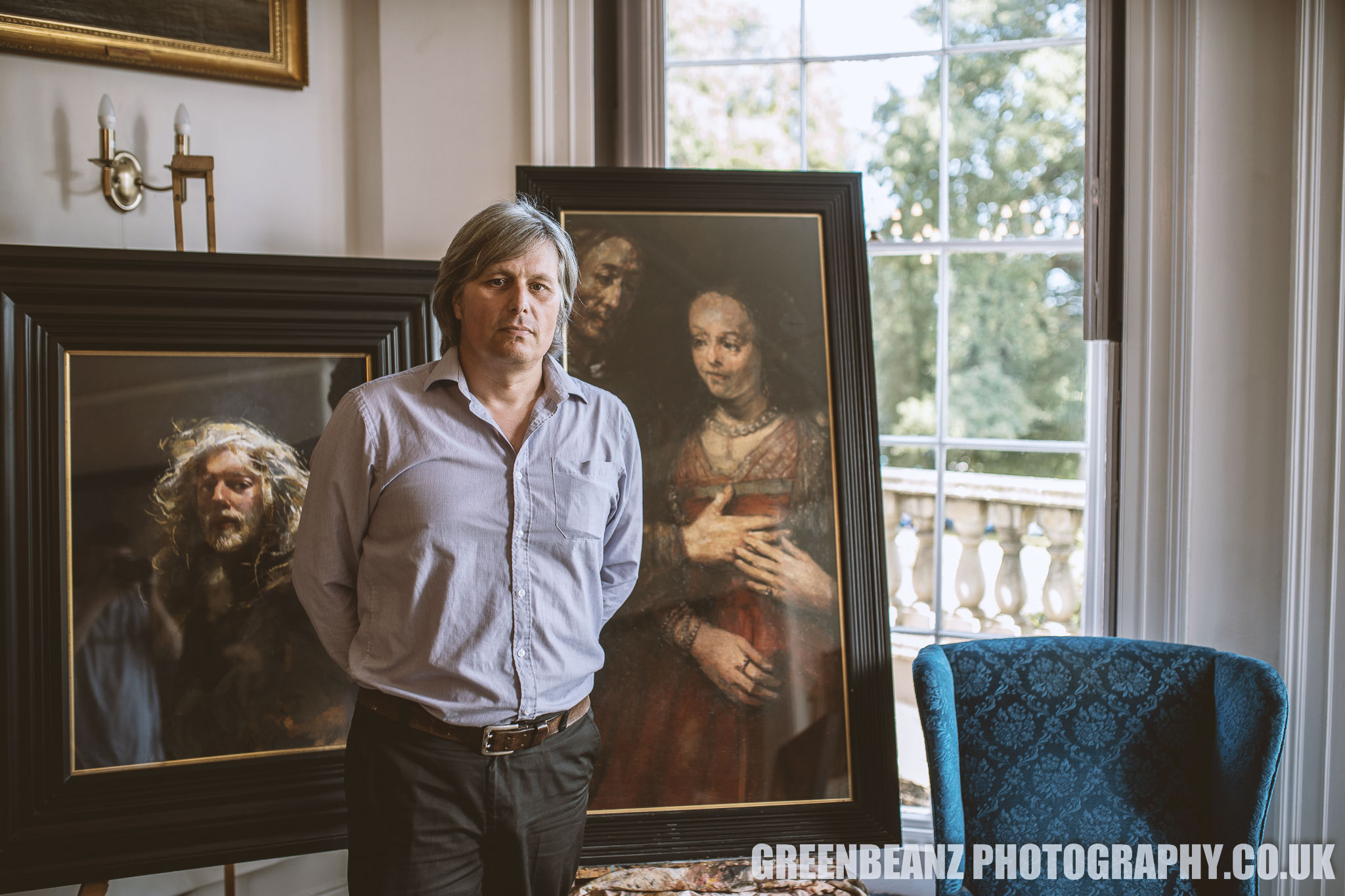 Reuben Lenkiewicz in front of his father Robert Lenkiewicz paintings at the show