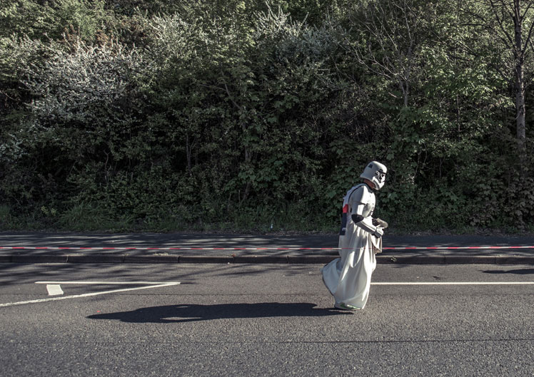 runner in a stormtrooper and white wedding dress